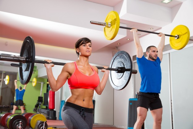 A man and woman doing a heavy weight lifting routine at Shape Up Fitness & Wellness Consulting